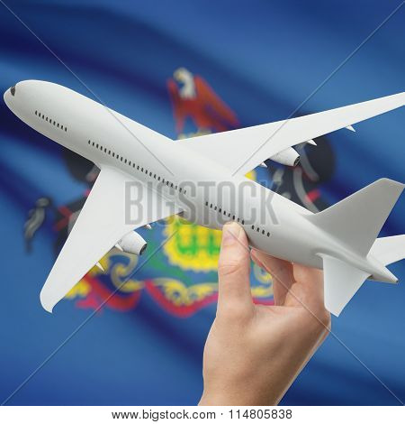 Airplane In Hand With Us State Flag On Background - Pennsylvania