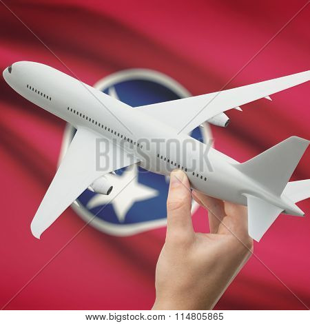 Airplane In Hand With Us State Flag On Background - Tennessee