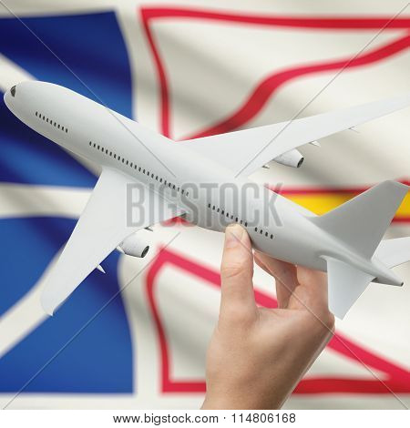 Airplane In Hand With Canadian Province Flag On Background - Newfoundland And Labrador
