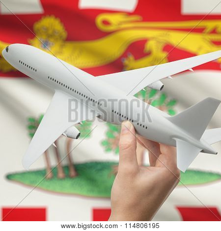 Airplane In Hand With Canadian Province Flag On Background - Prince Edward Island