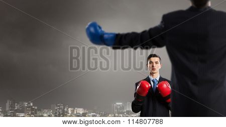 Businessman fighter in boxing gloves