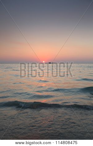 Beautiful sunset over sea and fishing boat