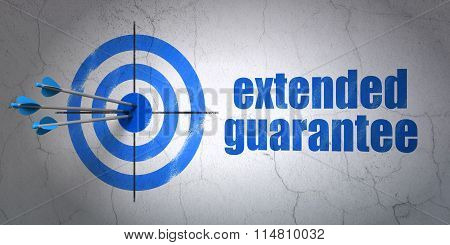 Insurance concept: target and Extended Guarantee on wall background