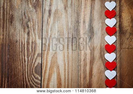 Red And White paper Hearts On The Clothesline On  Wood Backgrou