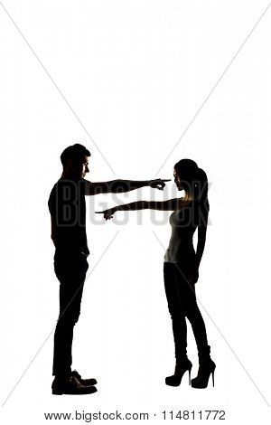Silhouette of Asian couple point to each other, concept of angry, unhappy etc.