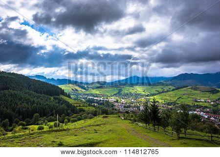 Mountain village before storm. Cloudy landscape