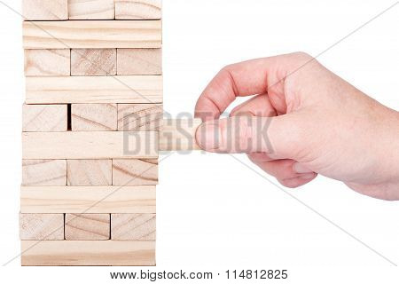 Wooden Blocks Tower And A Hand