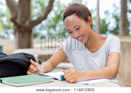 pretty african university student studying for examination