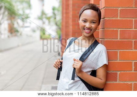 pretty african female university student in school