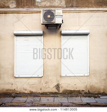 Wall With Two Windows And Air Conditioner