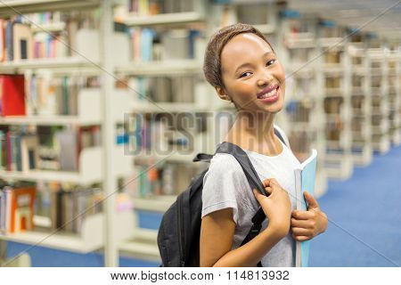 pretty female african college student in library