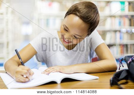 beautiful female african college student studying in library