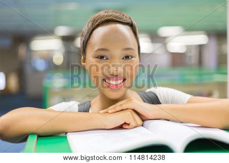 portrait of beautiful young college student reading a book