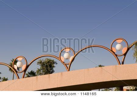 Unique Brass Lighting Along The Bridge