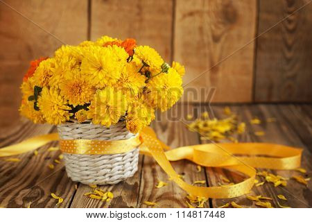 Beautiful Bouquet Of Yellow Chrysanthemums Flowers In Wicker Ba
