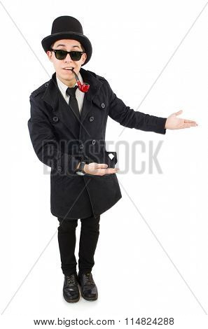 Young detective in black coat holding magnifying glass isolated