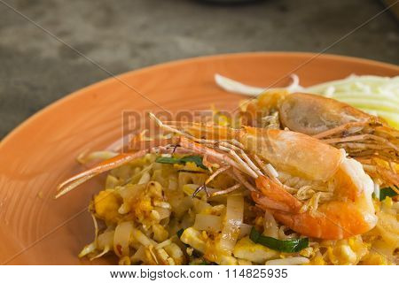 Asian noodles with shrimp and vegetables close-up (Pad Thai)