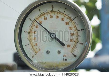 Old pressure gauge measuring instrument close up