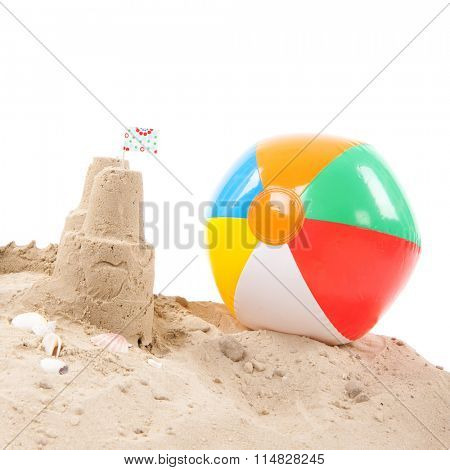 Beach with sandcastle and toys isolated over white background