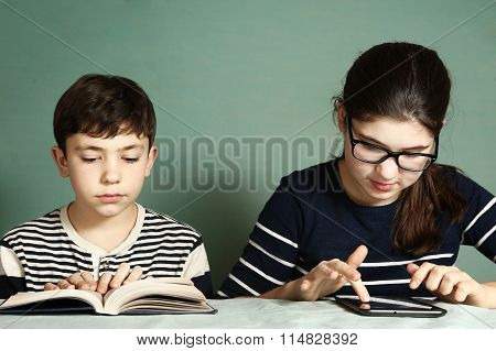 Boy Read Book  Girl  Play Tablet  Computer Games