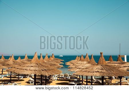 Vacation Holidays Background Wallpaper -  Beach Lounge Chairs Under Tents On Beach. Egypt Hotel Shar