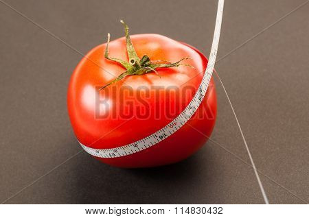 Diet With Red Tomato Concept.