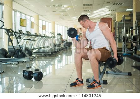 Guy working out in gym.