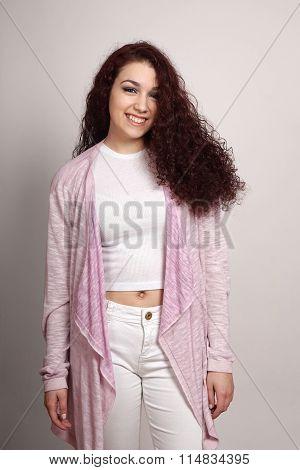 fashionable teenage girl with curly hair