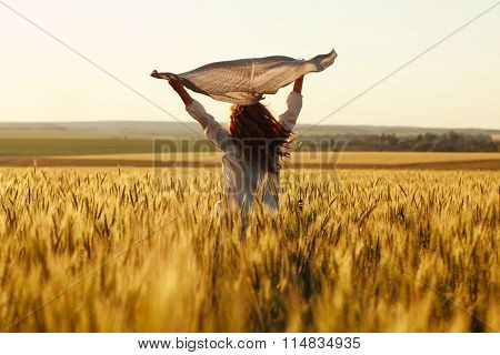 Happy Woman With A Scarf In The Field