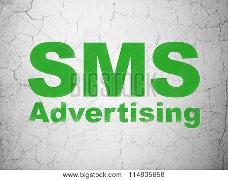 Advertising concept: SMS Advertising on wall background