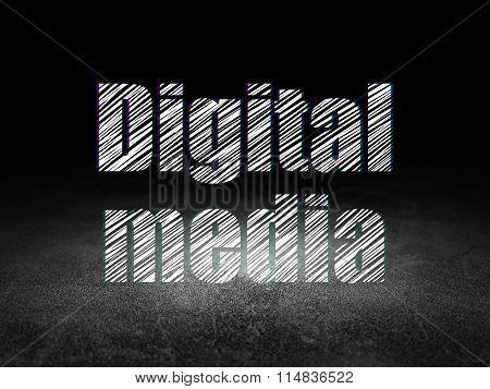 Advertising concept: Digital Media in grunge dark room