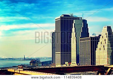 New York City Manhattan viewed from Brooklyn Bridge at sunset