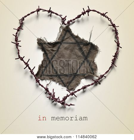 closeup of a Jewish badge and barbed wire forming a heart, and the text in memoriam, for the victims of the Holocaust