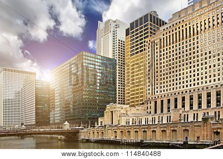 Chicago downtown riverfront, office buildings and river at sunset