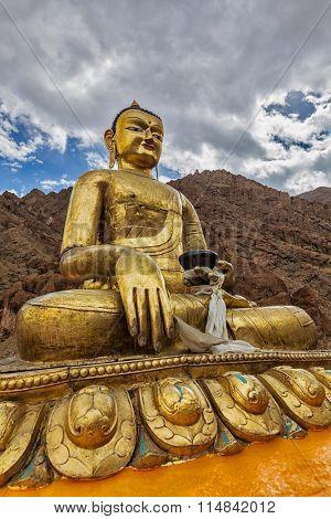 Sakyamuni Buddha statue near Hemis gompa (Tibetan Buddhist monastery). Hemis, Ladakh, India