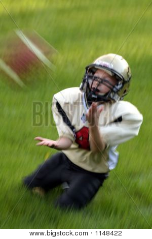 Youth Catching Football