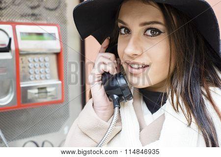 Young Woman At The Call Box
