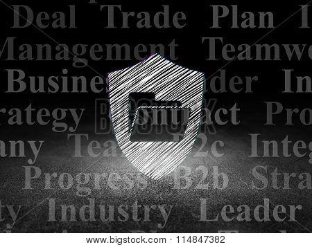 Finance concept: Folder With Shield in grunge dark room