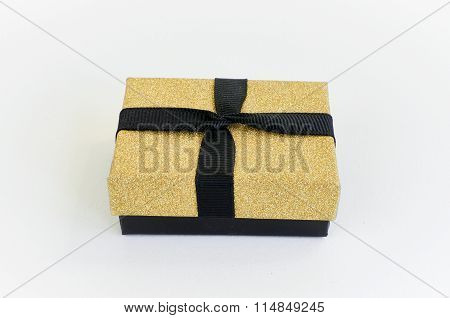 Gift box in gold duo tone with golden satin ribbon and bow separated