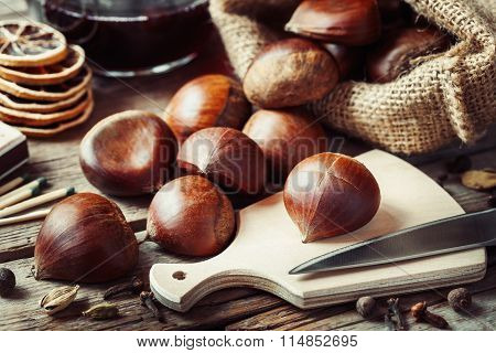 Chestnuts Ready To Cooking And Mulled Wine With Spices On Rustic Kitchen Table