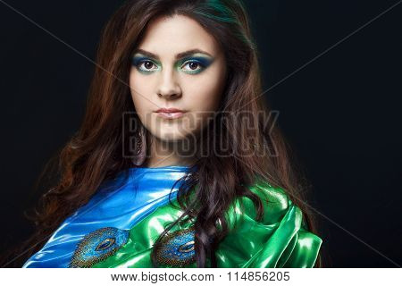 Beauty portrait of a beautiful girl in blue, green sari dress with peacock feather design. Attractiv