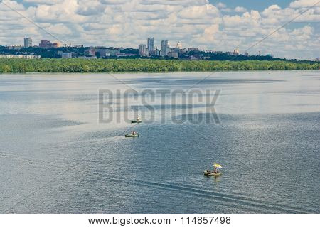 Small inflatable boats of fishermen on Dnepr river