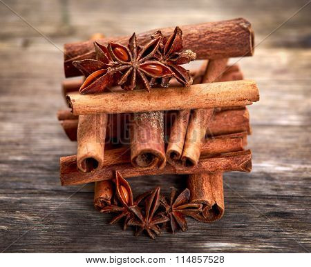 Cinnamon Sticks And Anice On Wooden Table. Selected Focus