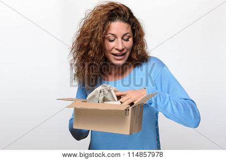 Attractive Young Woman Opening A Gift Box