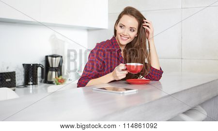 young woman drinking coffee at home in the morning