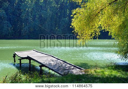 Small Wooden Pier Near The River