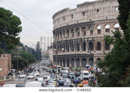 Colosseum On A Busy Street