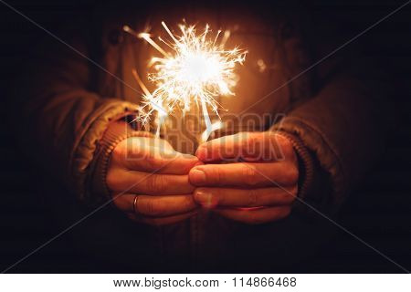Man Holding Bright Festive Christmas Sparkler In Hand, Tinted Ph
