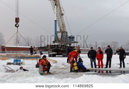 ST. PETERSBURG, RUSSIA - JANUARY 17, 2016: Emercom staff build the ice hole for celebrations of the Baptism of Jesus. In Eastern Christianity, the Baptism of Christ is commemorated on January 19