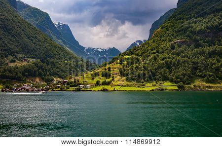 Norway. The Village On The Bank Of The Fjord Lit With The Sun After A Rain